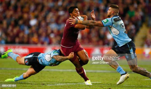 Anthony Milford of the Maroons runs at Josh Dugan of the Blues during game one of the State Of Origin series between the Queensland Maroons and the...