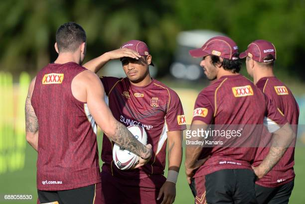 Anthony Milford talks tactics with team mates Darius Boyd and Jonathan Thurston during a Queensland Maroons State of Origin media opportunity at...