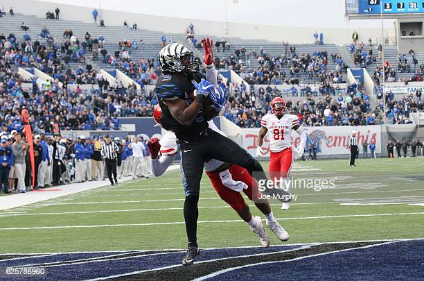 Anthony Miller of the Memphis Tigers catches a touchdown pass against Jeremy Winchester of the Houston Cougars on November 25 2016 at Liberty Bowl...