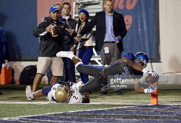Anthony Miller of the Memphis Tigers dives into the end zone for a touchdown against Lorentez Barbour of the Navy Midshipmenon November 7 2015 at...