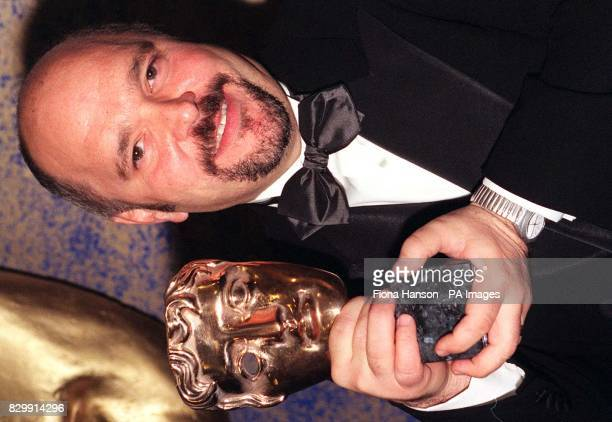 Anthony Minghella director of The English Patient with his award for Best Screenplay at the Royal Albert Hall in London the BAFTA award ceremony