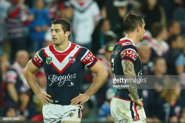 Anthony Minichiello and Mitchell Pearce of the Roosters look dejected after defeat during the NRL 1st Qualifying Final match between the Sydney...