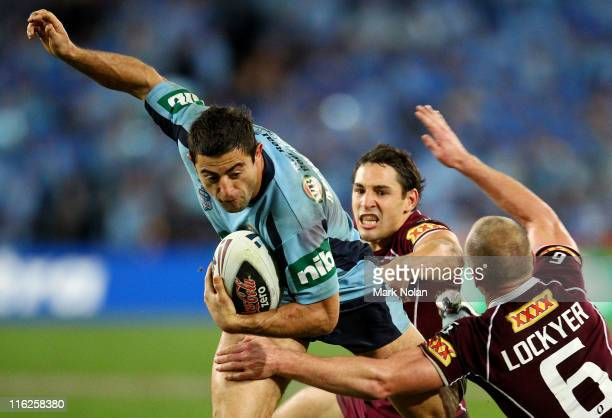 Anthony Minichiello of the Blues is tackled by Billy Slater and Darren Lockyer of the Maroons during game two of the ARL State of Origin series...