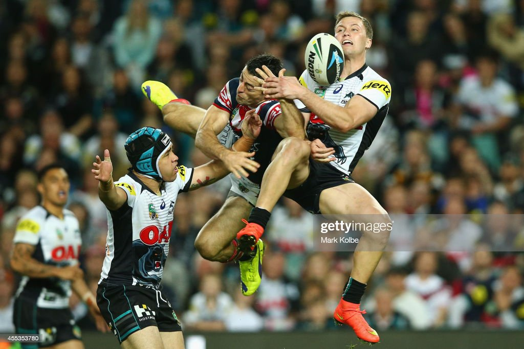 Anthony Minichiello of the Roosters and Matt Moylan of the Panthers compete for the high ball during the NRL 1st Qualifying Final match between the Sydney Roosters and the Penrith Panthers at Allianz Stadium on September 13, 2014 in Sydney, Australia.