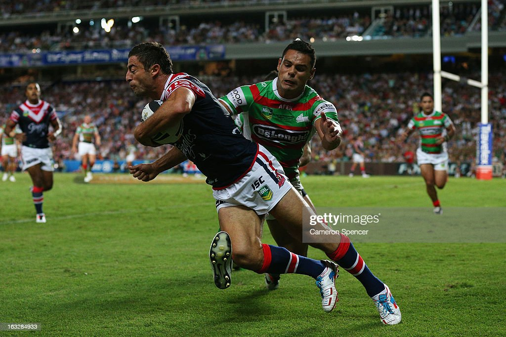 Anthony Minichiello of the Roosters is tackled in goal during the round one NRL match between the Sydney Roosters and the South Sydney Rabbitohs at Allianz Stadium on March 7, 2013 in Sydney, Australia.