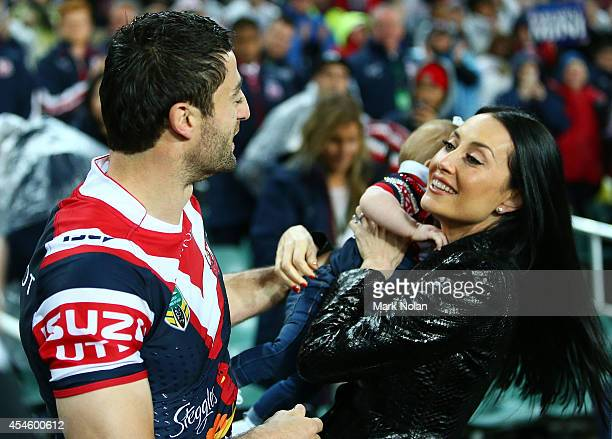 Anthony MInichiello of the Roosters kisses wife Terry Biviano before running on to the field for the round 26 NRL match between the Sydney Roosters...