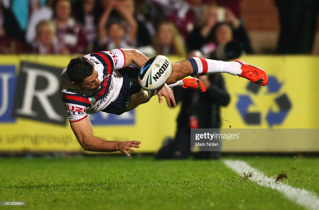 Anthony Minichiello of the Roosters tries to keep the ball in play during the round 16 NRL match between the Manly Sea Eagles and the Sydney Roosters at Brookvale Oval on June 27, 2014 in Sydney, Australia.