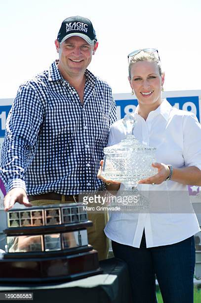 Anthony Mithen and Zara Phillips pose during the Magic Millions Barrier Draw on January 8 2013 in Surfers Paradise Australia