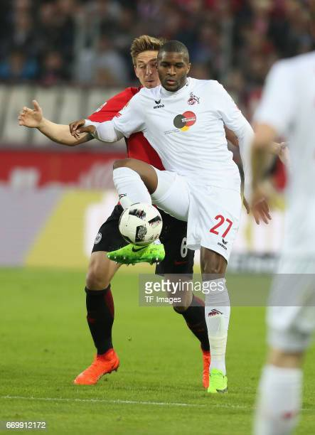 Anthony Modeste and Bastian Oczipka of Eintracht Frankfurt battle for the ball during the German Bundesliga soccer match between 1 FC Cologne and...