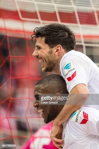 Anthony Modeste and Milos Jojic of Koeln celebrates the teams third goal during the Bundesliga match between 1 FC Koeln and Hertha BSC at...