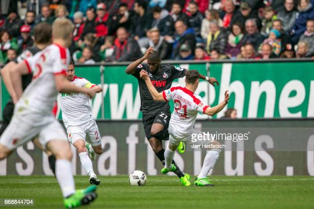 Anthony Modeste of Cologne and Dominik Kohr of FC Augsburg battle for the ball during the Bundesliga match between FC Augsburg and 1 FC Koeln at WWK...