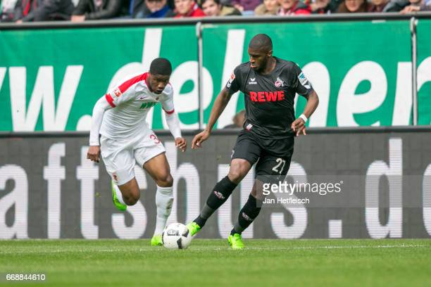 Anthony Modeste of Cologne and Konstantinos Stafylidis of FC Augsburg battle for the ball during the Bundesliga match between FC Augsburg and 1 FC...