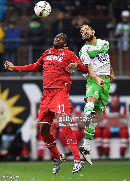 Anthony Modeste of Cologne and Ricardo Rodriguez of VfL Wolfsburg jump for the ball during the Bundesliga match between VfL Wolfsburg and 1 FC Koeln...