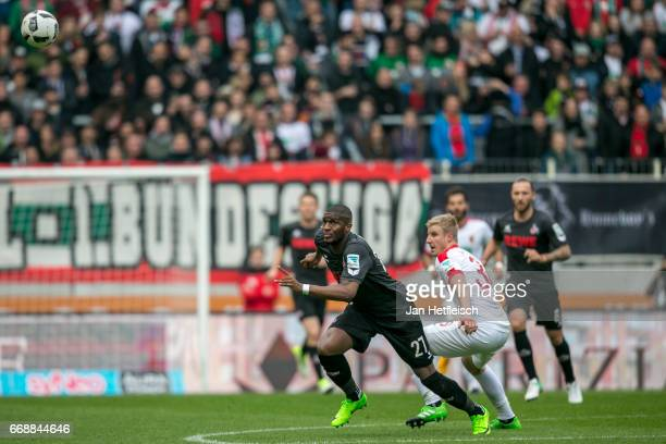 Anthony Modeste of Cologne battle for possession during the Bundesliga match between FC Augsburg and 1 FC Koeln at WWK Arena on April 15 2017 in...