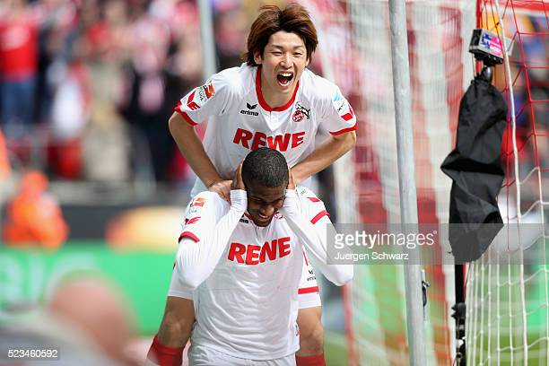 Anthony Modeste of Cologne celebrates with Yuya Osako after scoring the 2nd goal during the Bundesliga match between 1 FC Koeln and SV Darmstadt 98...