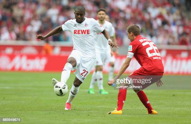 Anthony Modeste of Cologne controls the ball near Niko Bungert of Mainz during the Bundesliga match between 1 FC Koeln and 1 FSV Mainz 05 at...