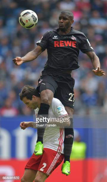 Anthony Modeste of Cologne is challenged by Dennis Diekmeier of Hamburg during the Bundesliga match between Hamburger SV and 1 FC Koeln at...
