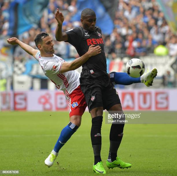 Anthony Modeste of Cologne is challenged by Mergim Mavraj of Hamburg during the Bundesliga match between Hamburger SV and 1 FC Koeln at...