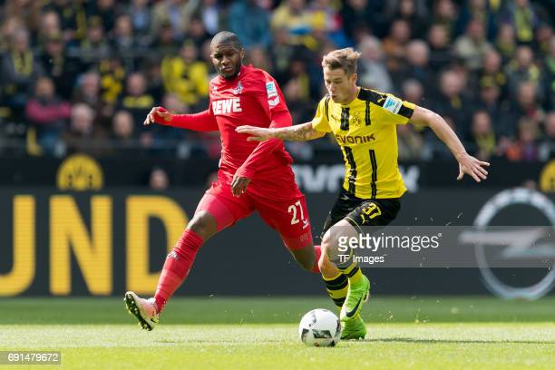 Anthony Modeste of Colonge and Erik Durm of Dortmund battle for the ball during the Bundesliga match between Borussia Dortmund and FC Koeln at Signal...