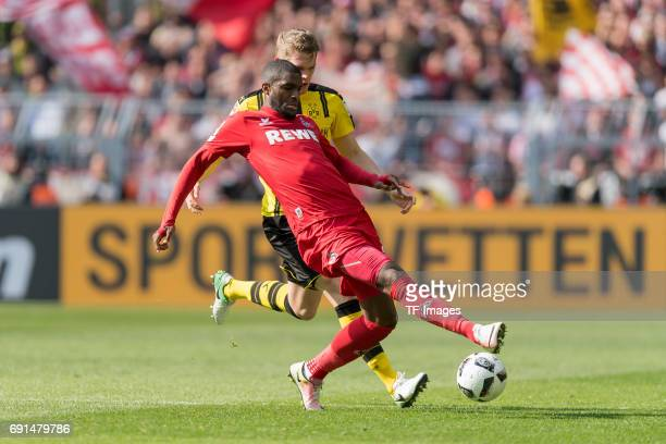 Anthony Modeste of Colonge and Matthias Ginter of Dortmund battle for the ball during the Bundesliga match between Borussia Dortmund and FC Koeln at...