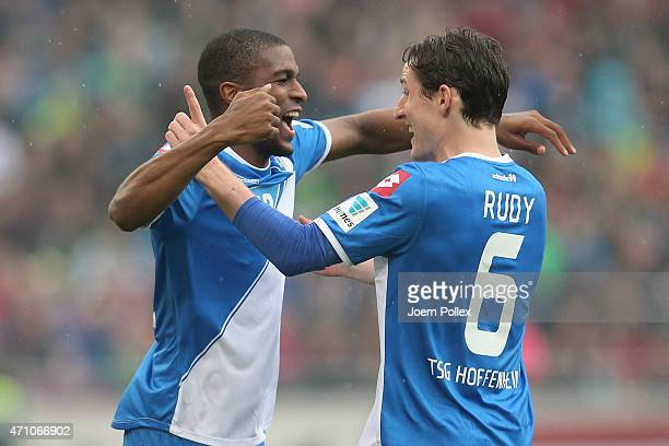 Anthony Modeste of Hoffenheim celebrates with his team mate Sebastian Rudy after scoring his team's first goal during the Bundesliga match between...