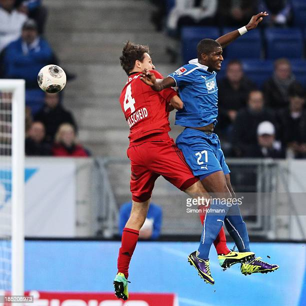 Anthony Modeste of Hoffenheim jumps for a header with Philipp Wollscheid of Leverkusen during the Bundesliga match between 1899 Hoffenheim and Bayer...