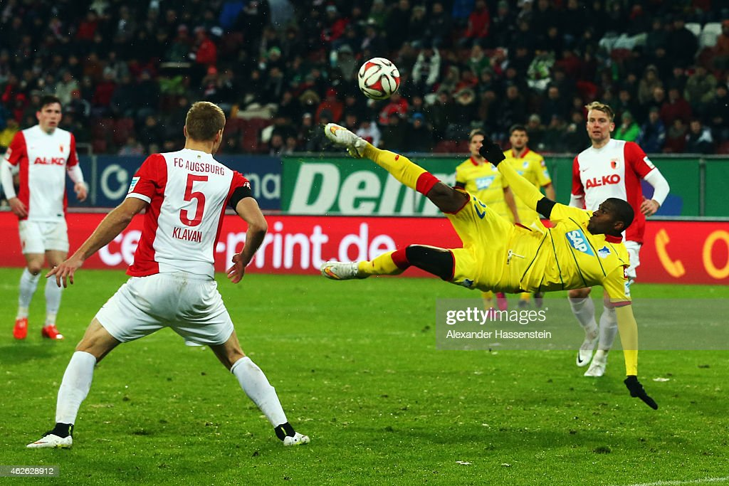 Anthony Modeste of Hoffenheim tries to score with a bicycle kick against Ragnar Klavan of Augsburg during the Bundesliga match between FC Augsburg and 1899 Hoffenheim at SGL Arena on February 1, 2015 in Augsburg, Germany.
