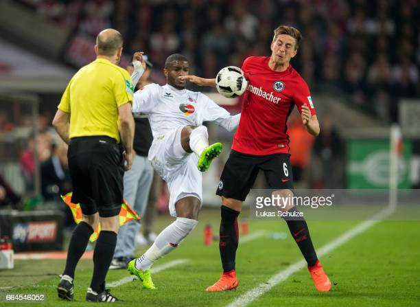 Anthony Modeste of Koeln and Bastian Oczipka of Frankfurt in action during the Bundesliga match between 1 FC Koeln and Eintracht Frankfurt at...