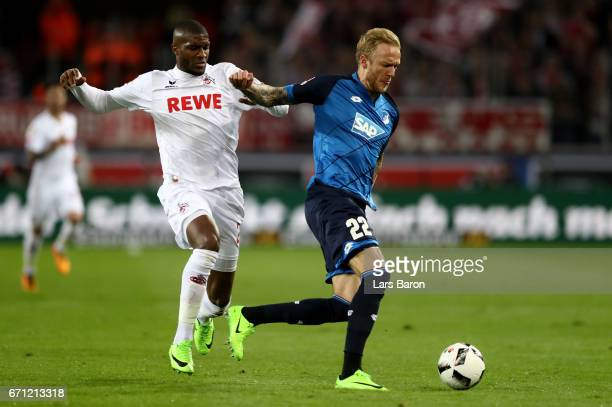 Anthony Modeste of Koeln and Kevin Vogt of Hoffenheim battle for the ball during the Bundesliga match between 1 FC Koeln and TSG 1899 Hoffenheim at...