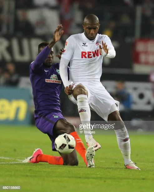 Anthony Modeste of Koeln and Lamine Sane of Bremen battle for the ball during to the Bundesliga match between 1 FC Koeln and Werder Bremen at...