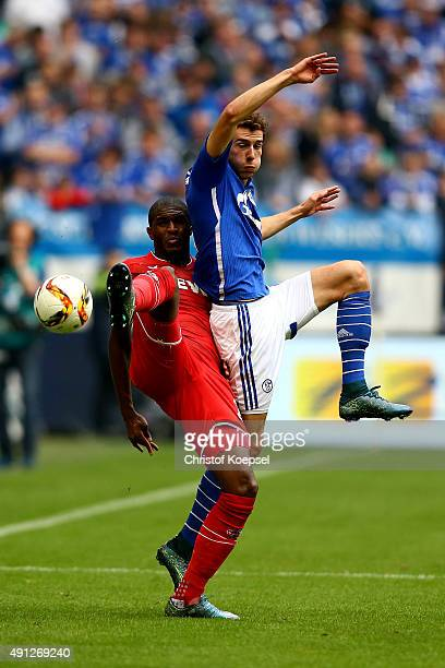 Anthony Modeste of Koeln and Leon Goretzka of Schalke go up for a header during the Bundesliga match between FC Schalke 04 and 1 FC Koeln at...