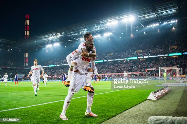 Anthony Modeste of Koeln and Leonardo Bittencourt of Koeln celebrate their teams fourth goal during the Bundesliga match between 1 FC Koeln and...
