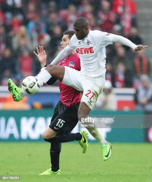 Anthony Modeste of Koeln and Sebastian Langkamp of Berlin battle for the ball during the Bundesliga match between 1 FC Koeln and Hertha BSC at...