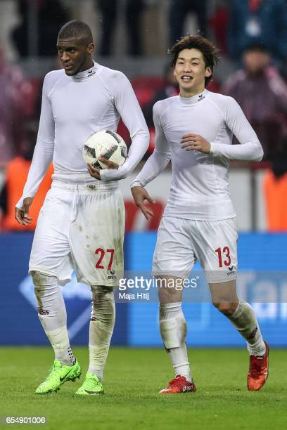 Anthony Modeste of Koeln and Yuya Osako celebrate after the Bundesliga match between 1 FC Koeln and Hertha BSC at RheinEnergieStadion on March 18...