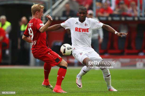 Anthony Modeste of Koeln battles for the ball with Julian Brandt of Bayer 04 Leverkusen during the Bundesliga match between Bayer 04 Leverkusen and 1...