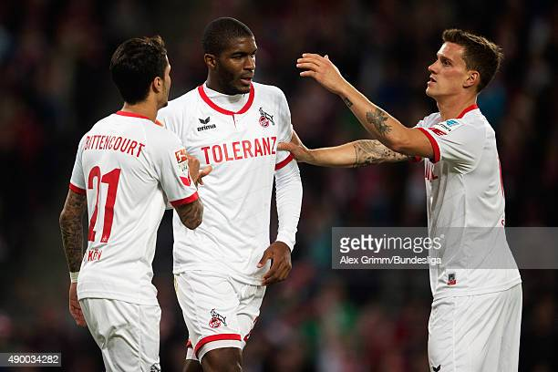 Anthony Modeste of Koeln celebrates his team's first goal with team mates Leonardo Bittencourt and Simon Zoller during the Bundesliga match between 1...