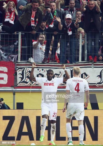 Anthony Modeste of Koeln celebrates his team's second goal with team mate Frederik Soerensen during the Bundesliga match between 1 FC Koeln and...