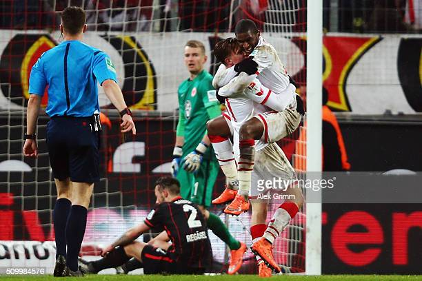 Anthony Modeste of Koeln celebrates his team's third goal with team mate Yannick Gerhardt during the Bundesliga match between 1 FC Koeln and...