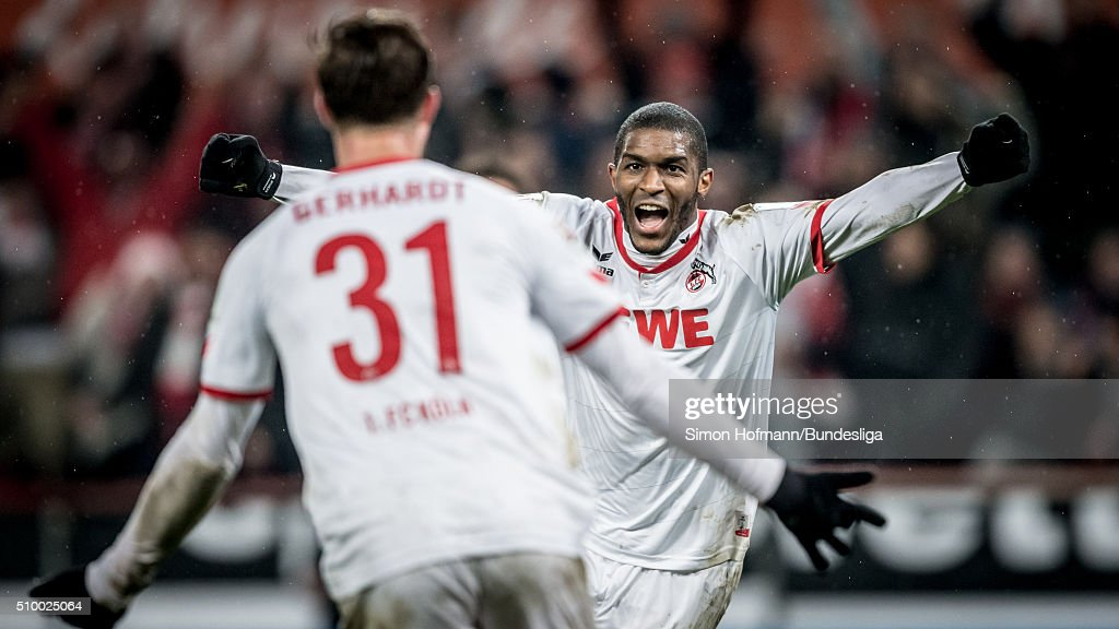 Anthony Modeste of Koeln celebrates his team's third goal with team mate Yannick Gerhardt (front) during the Bundesliga match between 1. FC Koeln and Eintracht Frankfurt at RheinEnergieStadion on February 13, 2016 in Cologne, Germany.