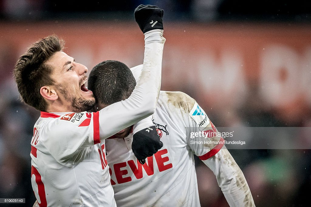 Anthony Modeste of Koeln celebrates his team's third goal with team mate Filip Mladenovic during the Bundesliga match between 1. FC Koeln and Eintracht Frankfurt at RheinEnergieStadion on February 13, 2016 in Cologne, Germany.
