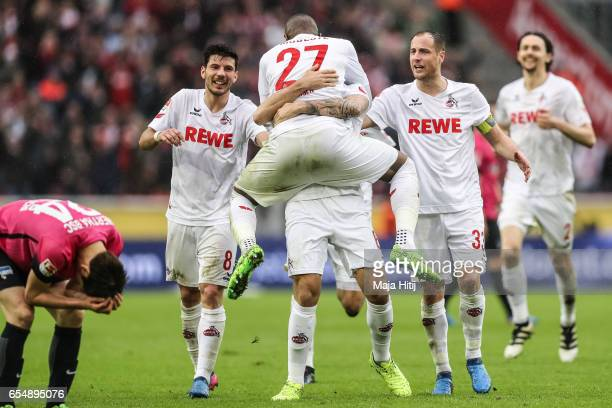 Anthony Modeste of Koeln celebrates with his team mates after scoring his team's fourth goal to make it 41 during the Bundesliga match between 1 FC...