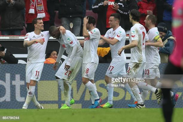 Anthony Modeste of Koeln celebrates with his teammates after scoring his team's third goal to make it 30 during the Bundesliga match between 1 FC...