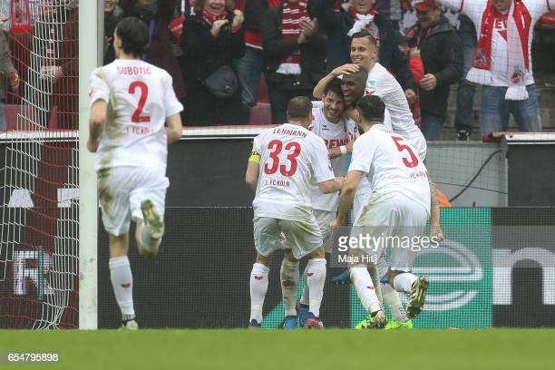 Anthony Modeste of Koeln celebrates with his teammates after scoring his team's second goal to make it 20 during the Bundesliga match between 1 FC...