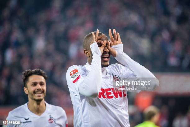 Anthony Modeste of Koeln celebrates with Leonardo Bittencourt after scoring his teams fourth goal during the Bundesliga match between 1 FC Koeln and...