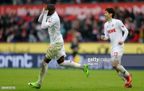 Anthony Modeste of Koeln celebrates with team mates after scoring his team's fourth goal during the Bundesliga match between 1 FC Koeln and Hertha...