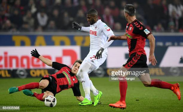 Anthony Modeste of Koeln is challenged by Caglar Soeyuencue of Freiburg and Marc Torrejon of Freiburg during the Bundesliga match between SC Freiburg...