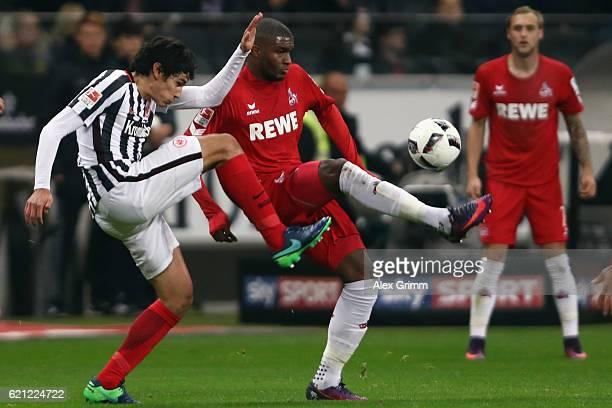Anthony Modeste of Koeln is challenged by Jesus Vallejo of Frankfurt during the Bundesliga match between Eintracht Frankfurt and 1 FC Koeln at...