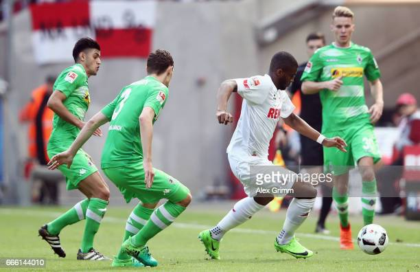 Anthony Modeste of Koeln is challenged by Mahmoud Dahoud and Andreas Christensen of Moenchengladbach during the Bundesliga match between 1 FC Koeln...