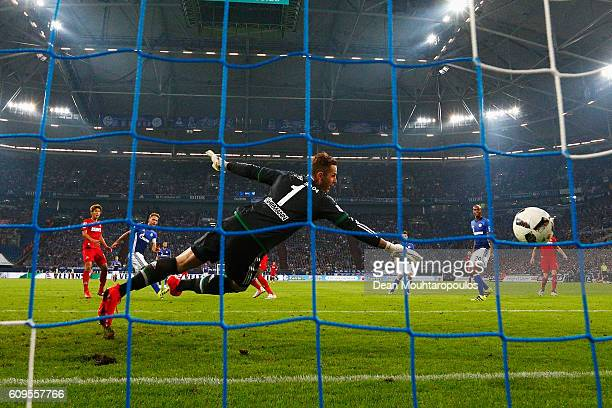 Anthony Modeste of Koeln shoots and scores a goal past Goalkeeper Ralf Fahrmann of Schalke during the Bundesliga match between FC Schalke 04 and 1 FC...