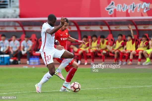 Anthony Modeste of Tianjin Quanjian and Nikola Petkovic of Yanbian Fude compete for the ball during the 19th round match of 2017 Chinese Football...